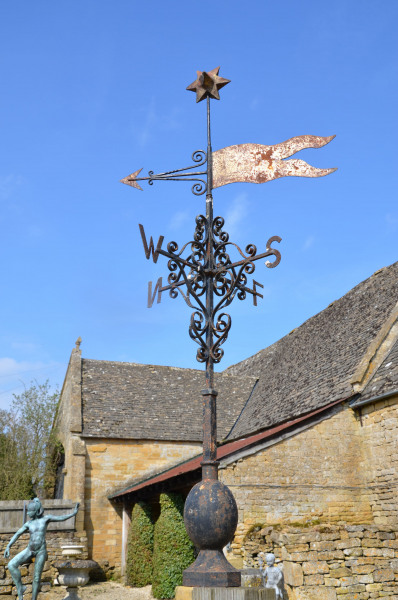 A wrought and cast iron weather vane