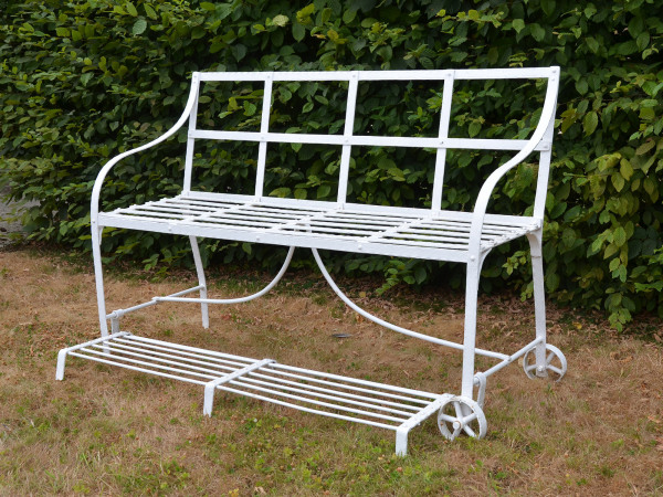 A Regency wrought iron garden games seat