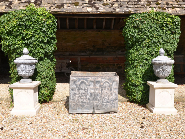 A pair of mid 20th century lead finial urns
