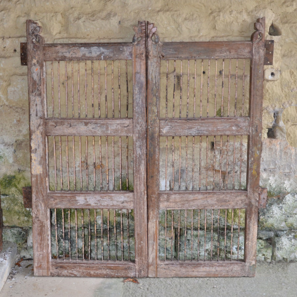 A pair of vintage wood and iron garden gates