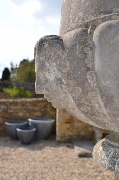 A magnificent marble Campana shaped urn on circular pedestal