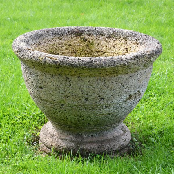 A circular stone planter