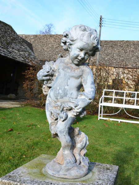 A lead figure depicting Summer as a cherub