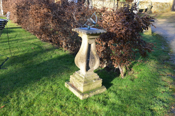 A carved Bath stone sundial base