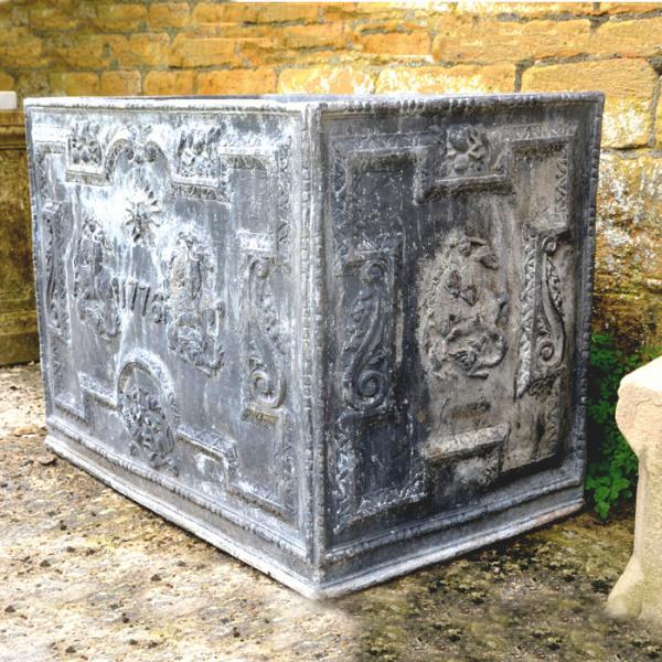 A lead cistern, circa 1930, spuriously dated 1776