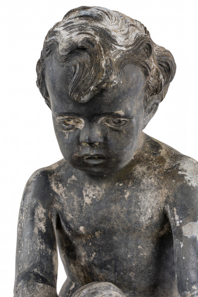 An early 20th century lead fountain in the form of a boy holding a fish