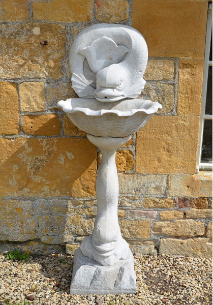 An early 20th century white marble wall fountain