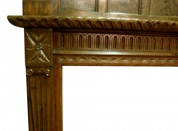 A late 19th century Oak fire surround partially made up from period elements