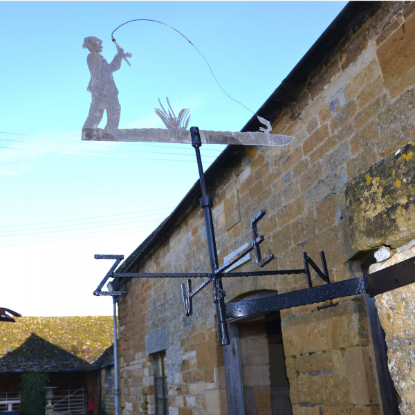 A vintage cut zinc weathervane of a fisherman in action!