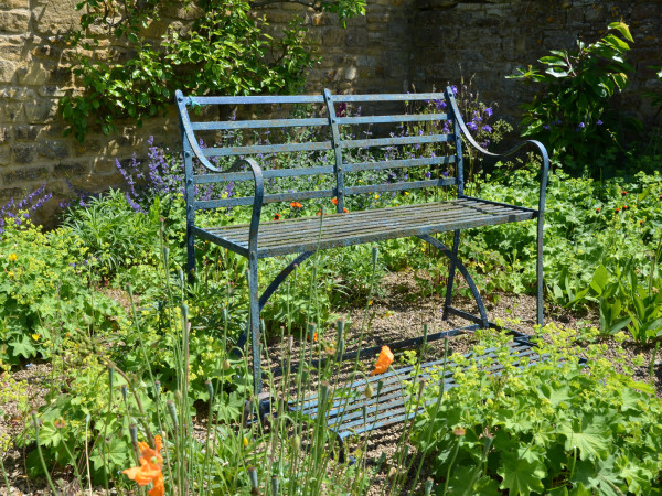 A mid 19th century wrought iron games seat