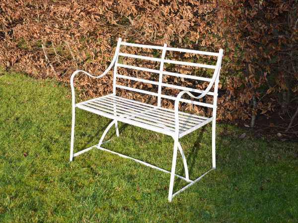 An early 19th century wrought iron garden seat