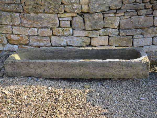 A long French stone trough / garden planter