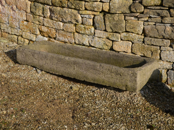A long French stone trough / garden planter