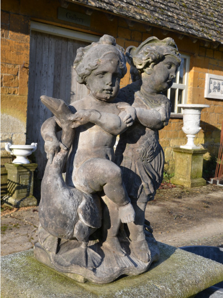 A late 17th century Dutch carved sandstone allegorical group of Jupiter and Mercury