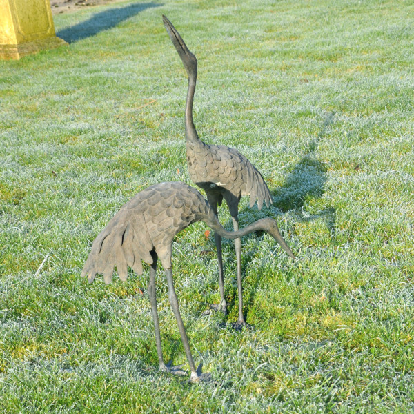A pair of Japanese Taisho period (1912-1926) bronze cranes