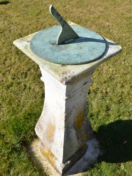 An elegant Georgian Portland stone sundial