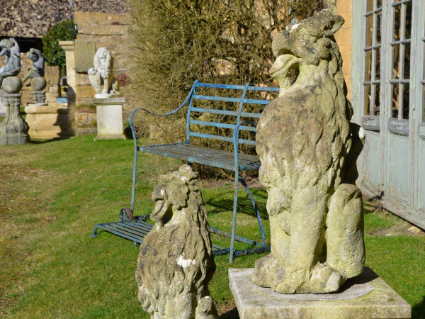 A pair of 19th century carved Bath stone griffins