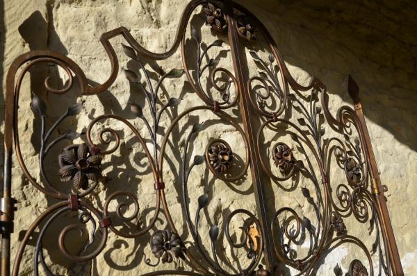 A pair of decorative ironwork gates