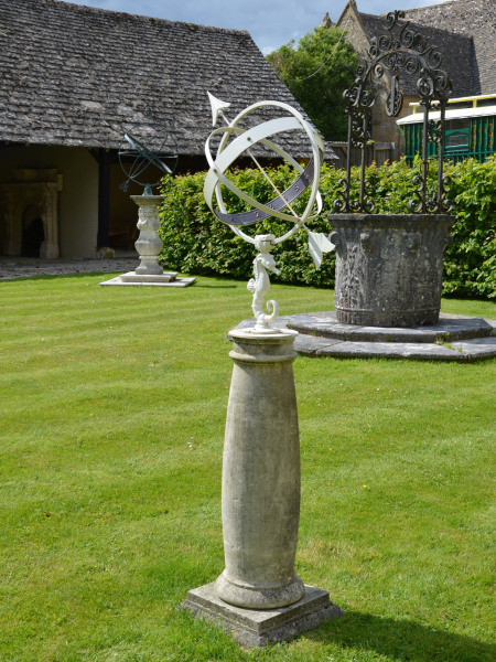 A 20th century Bath stone sundial base surmounted by a Swedish Armillary with sea horse support designed by Sune Rooth
