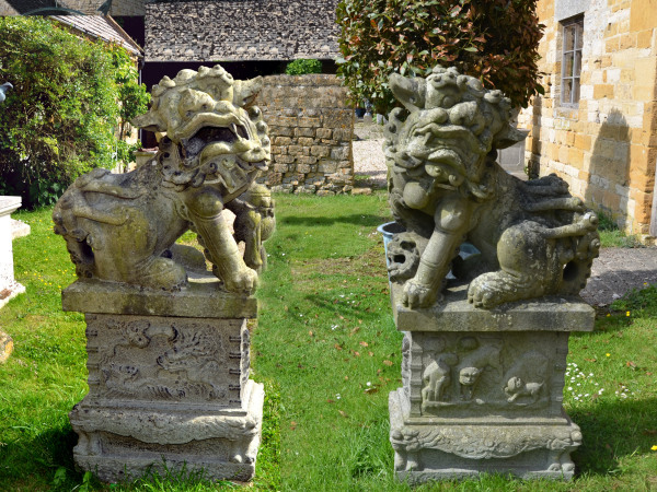A pair of late 19th century Japanese carved granite Dogs of Foo