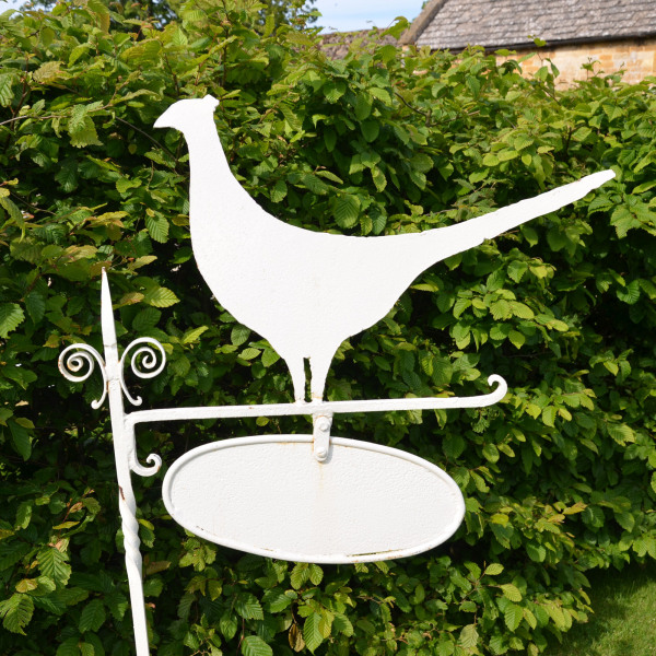 A Folk Art iron house sign with pheasant silhouette