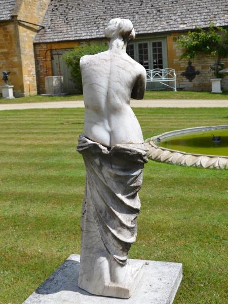An alabaster figure of the 'Venus de Milo'