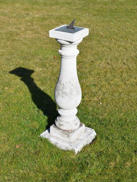 A Portland stone baluster sundial