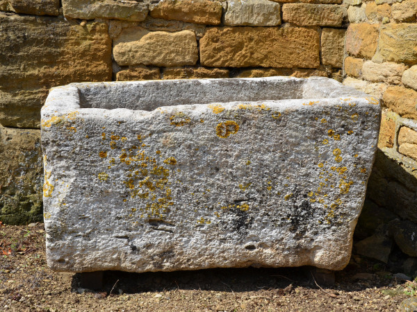An 18th century limestone trough with good weathering and patination