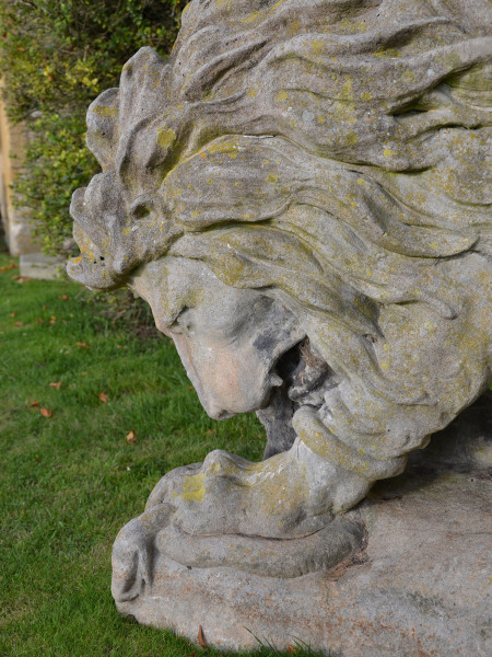 A large 19th century French composition stone Lion attacking a snake