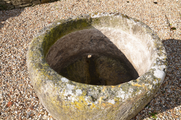 A large antique circular trough with good weathering and patination