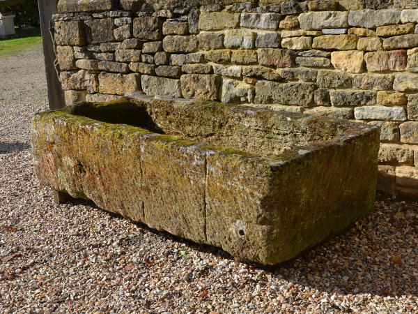 A large antique limestone trough with good weathering and patination