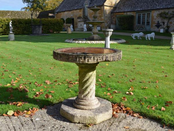 A Bath stone birdbath