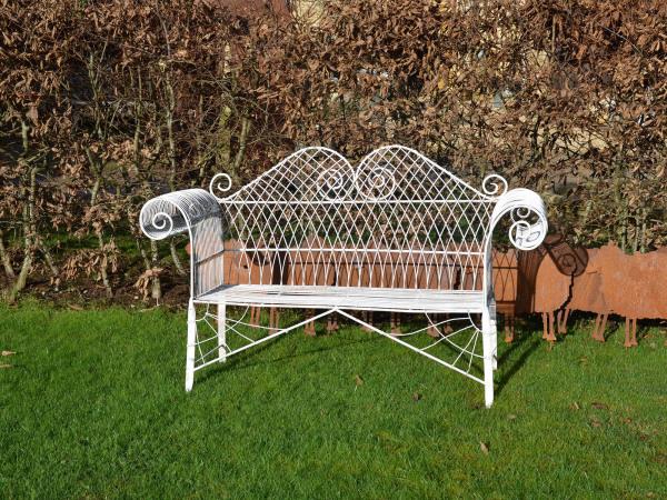 A decorative mid 20th century wirework garden bench