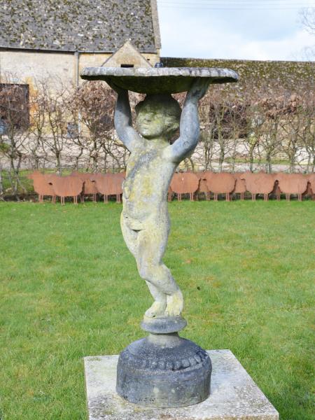 A mid-20th century lead birdbath/fountain