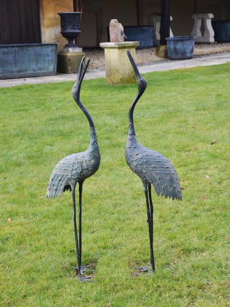A pair of Japanese Taisho period (1912-1926) bronze cranes
