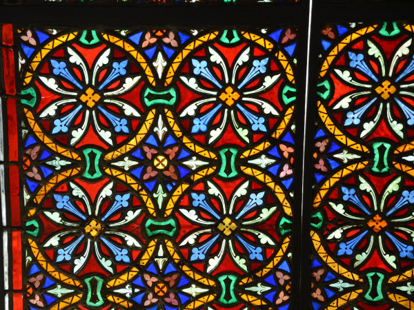 A pair of 19th century stained and painted glass windows